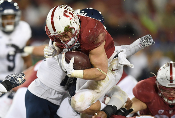 889ef85a704 PALO ALTO, CA - NOVEMBER 26: Christian McCaffrey #5 of the Stanford  Cardinal leaps over the line for a three yard gain and a first down against  the Rice ...