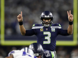 NFC West quarterback rankings - Russell Wilson signals before a play against the Dallas Cowboys