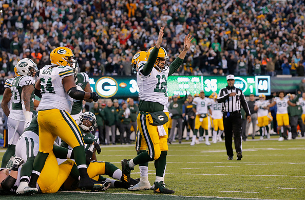 Green Bay Packers - Aarson Rodgers celebrates touchdown
